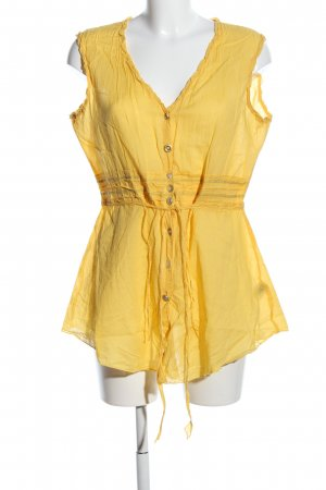 Apanage Blusa sin mangas amarillo pálido look casual