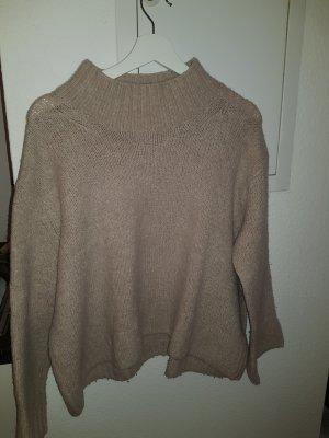 apricotfarbener Pullover mit Kragen
