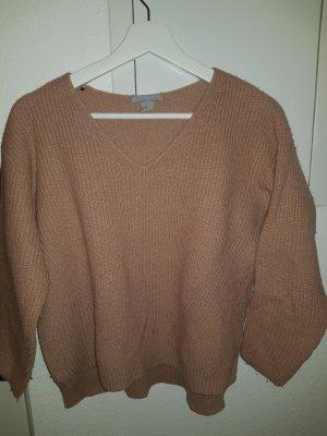 apricotfarbener Pullover mit V-Auschnitt