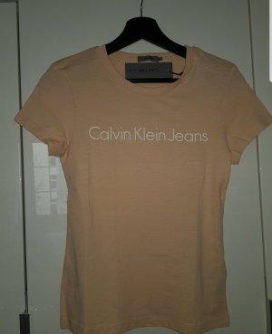 apricotfarbenes T-Shirt mit Aufschrift
