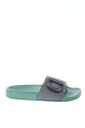 Arena Chaussons de bain noir-vert style décontracté