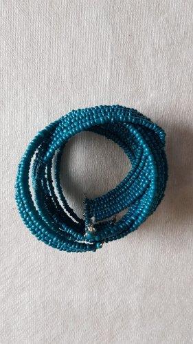 Pulsera azul neón