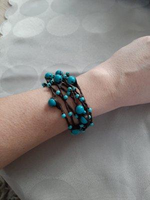 Mouwband donkerbruin-turkoois