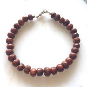Armband aus dunkelbraunen Holzperlen