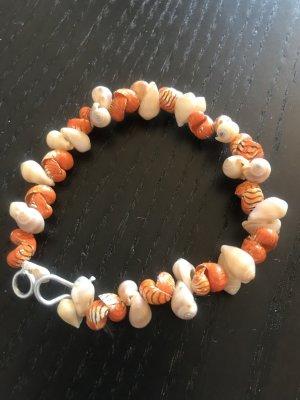 Braccialetto sottile arancione chiaro-crema