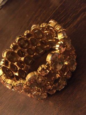 Bracelet de bras orange doré