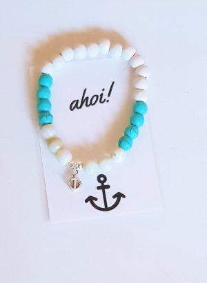 Bracelet en perles blanc-bleu clair