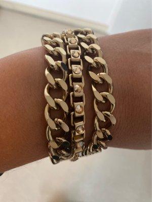 Armband Max Mara goldfarben mit Steinen.