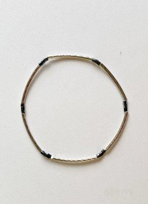 Armband mit silbernen Röhren, 18 cm lang