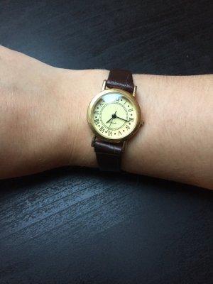 Reloj analógico marrón-negro-color oro