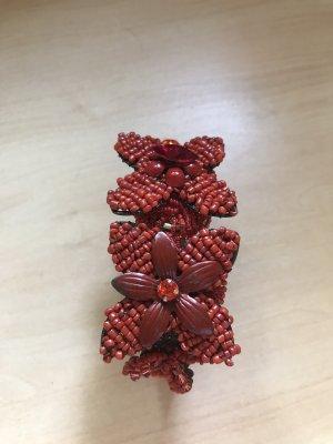 Bracelet de bras rouge foncé