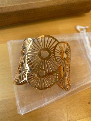 Sztywna bransoletka w kolorze różowego złota