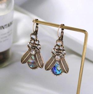 Boucle d'oreille incrustée de pierres bronze-bleu azur