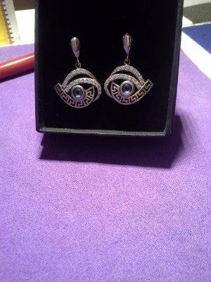 Boucle d'oreille incrustée de pierres argenté-bleu acier argent