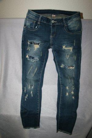 ausgefallene Jeans mit Cutouts und Nietenspiel in blau Gr. L