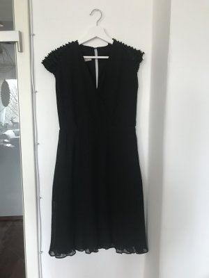 Ausgefallenes Kleid mit Rüschen und Falten von MANGO Moments