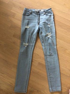 Ausgewaschene Skinny Jeans mit Rissen