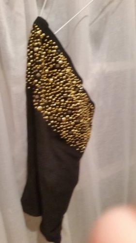 Bandautop aus einer kleinen Boutique mit goldenen Nieten