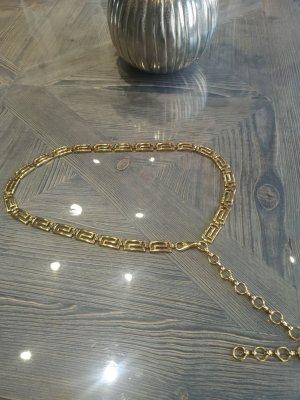 Cinturón pélvico color oro