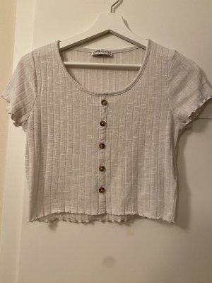 Bauchfreies Knopf T-Shirt