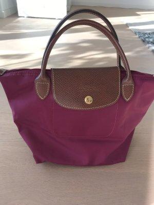 Beerenfarbene Longchamp Tasche