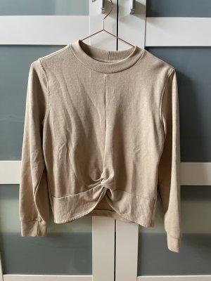 Beige Pullover mit Knoten