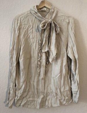 Beigefarbene Bluse mit Rüschen und Band zum herausnehmen