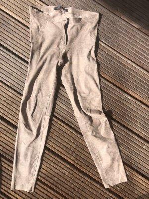 Beigefarbene Leggings in -Optik