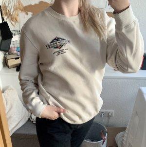 beiger Sweater mit Aufdruck