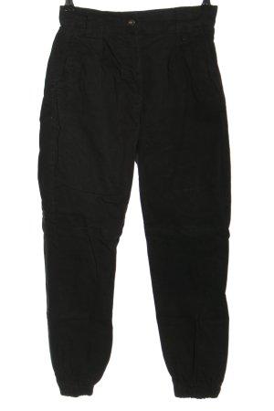 Bershka Pantalón de camuflaje negro look casual