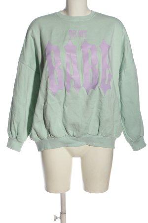 Bershka Sweatshirt grün-lila Schriftzug gedruckt Casual-Look