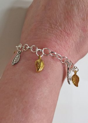 no name Armbandje met bedels zilver-goud Gemengd weefsel