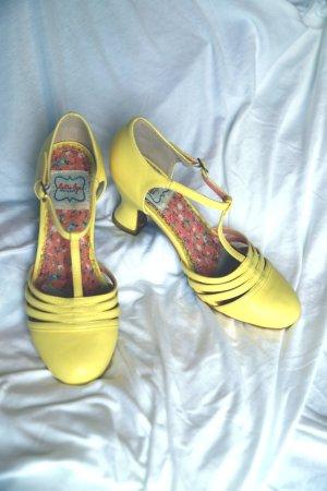 ellie Zapatos de tacón con barra en T amarillo pálido
