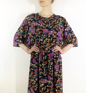 Bezauberndes Vintagekleid mit Retroprint, Taschen und Fledermausärmeln aus Seide