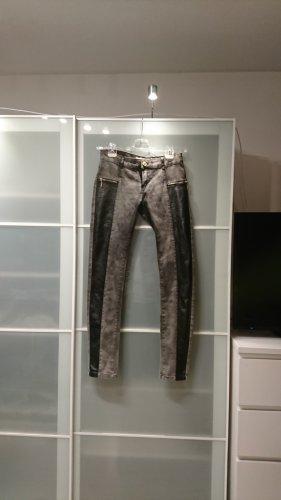 Bikerstil Jeans Kunstledereinsatz