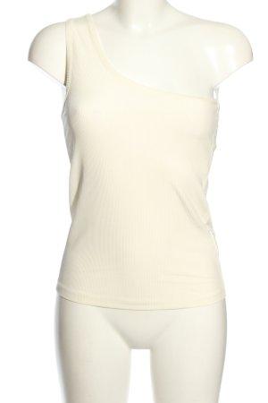 Birgitte Herskind Haut avec une épaule dénudée blanc cassé