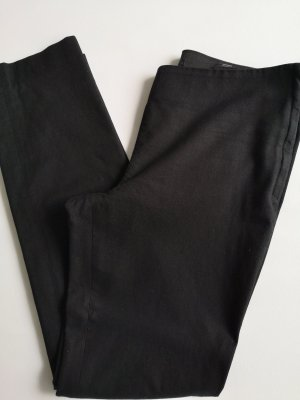 Black ankle length trousers by COS