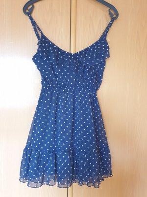 Blau weiß gepunktetes Sommerkleid mit Volant Cordon