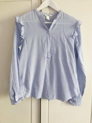 Blau-weiß gestreifte Bluse mit Rüschen