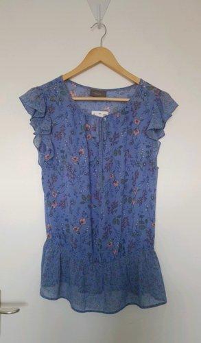 Blaue Bluse mit Blumen