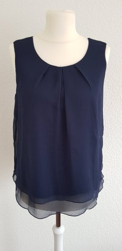 Blaue Bluse ohne Arm