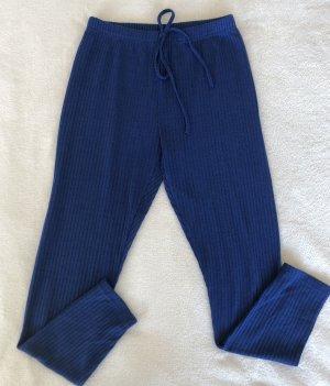 Blaue Leggins mit zwei Bändel am Bund