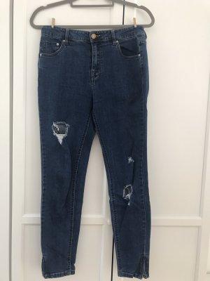 Blaue ripped Jeans mit Reisverschluss