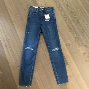 Blaue Skinny Jeans