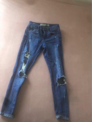 blaue skinny jeans middle waist gr. 32