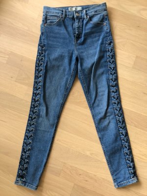 Blaue Stretch Jeans mit Schnürung & Ösen