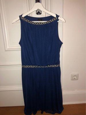 Blaues knielanges Kleid mit schwarzweißen Details