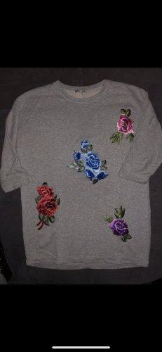 Blumen bestickter Sweater