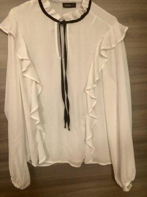Blusa con volantes blanco puro-negro