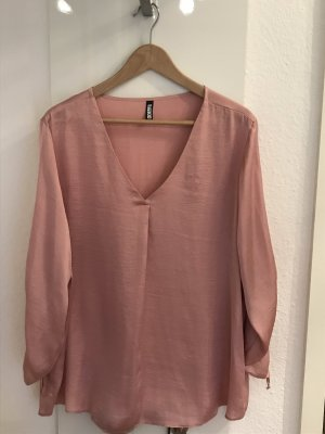 Blouse brillante or rose
